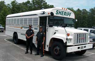 Transportation officers with vehicle